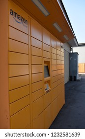 San Jose, California, USA - November 17, 2018 - Outdoor yellow Amazon locker kiosk outside 7-Eleven convenience store. Amazon Locker program addresses concerns of parcels or delivery being stolen.