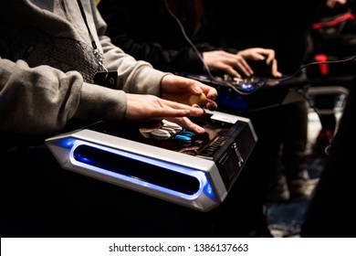 SAN JOSE, CA/USA - MARCH 30, 2019: eSports competitor playing Street Fighter V SFV on a Qanba Obsidian fightstick at video game tournament NCR NorCal Regionals 2019.