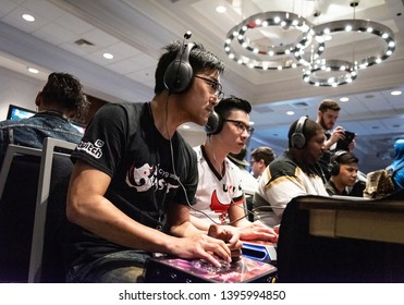"""SAN JOSE, CA/USA - MARCH 30, 2019: eSports competitor Bruce """"GamerBee"""" Hsiang versus Li-Wei """"Oil King"""" Lin in Street Fighter V: Arcade Edition SFV match at video game tournament NCR NorCal Regionals."""
