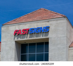 SAN JOSE, CA/USA - MAY 24, 2014: Fastsigns retail store exterior. Fastsigns provides a custom sign and graphics products to companies.