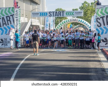 San Jose, CA/USA - May 28, 2016: The Color Run 5K run in downtown San Jose, CA. The untimed run has no winners or prizes, but runners are showered with colored powder, at stations along the run.