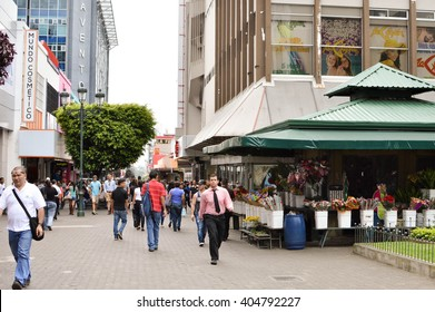 San Jose, Costa Rica - August 18, 2015: People are seen walking down the streets in downtown of San Jose, Costa Rica on August 18, 2015