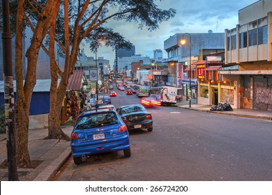 SAN JOSE, COSTA RICA - JANUARY 18: Twilight scene along the Avenida Central from Plaza de la Democracia where the National Musem is located towards the city centre on January 18, 2015.