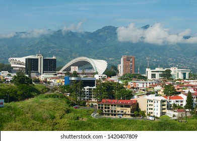 San Jose, Costa Rica - June 18, 2012: View to the National Stadium and residential buildings with mountains at the background in San Jose, Costa Rica.