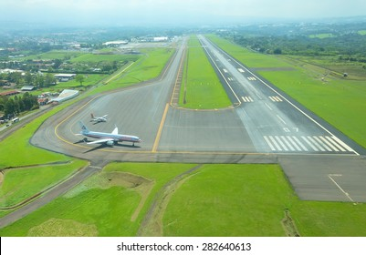 SAN JOSE, COSTA RICA - May 10: Aerial view of runway at Juan Santamaria International Airport on May 10, 2014 in San Jose, the capital of Costa Rica. This airport is the primary airport in the country
