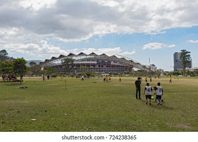 SAN JOSE, COSTA RICA-MARCH 04, 2017: Football playing children in front of the national stadium in San Jose, Costa Rica