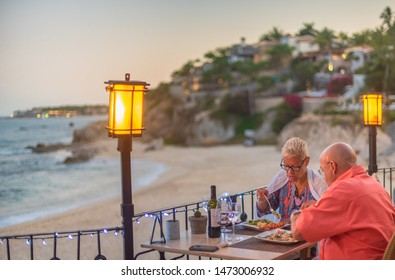 San Jose Del Cabo, Los Cabos / Mexico - Mar 2019 Beach restaurant / bar with sea view illustrative Outdoor restaurant tables, dinner setting on the beach at evening