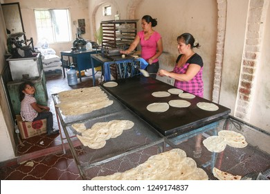 SAN JOSE DEL CABO, MEXICO -MARCH 16, 2012: Local women make home made  tortillas in a small bakery in San JOse del Cabo, Mexico