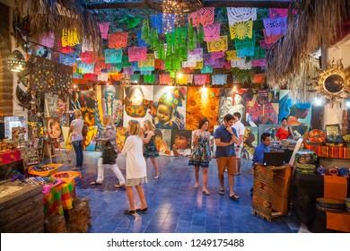 SAN JOSE DEL CABO, MEXICO -MARCH 16, 2012:  People visit art and souvenir gallery in San Jose Del Cabo, Mexico