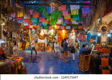 SAN JOSE DEL CABO, MEXICO -MARCH 16, 2012:  People visit art and souvenir gallery in San Jose Del Cabo, Mexico