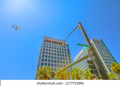 San Jose, United States - August 12, 2018: Adobe crossroad with an airplane flying on top from San Jose. Adobe is leader in software for graphic, photography, video making and a big microstock agency.