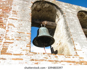 San Juan Capistrano, California USA - January 24, 2012: One large church bell of historic Mission San Juan Capistrano hangs in the bell tower or campanario.