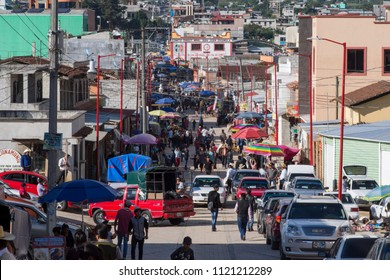 SAN JUAN CHAMULA, CHIAPAS, MEXICO - JUNE 23, 2018: The main avenue in downtown San Juan Chamula becomes a crowded marketplace on weekends.