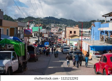 SAN JUAN CHAMULA, CHIAPAS, MEXICO - JUNE 23, 2018: Cars and people crowd the main avenue in downtown San Juan Chamula during the annual festival of San Juan the Baptist.