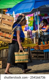 SAN JUAN CHAMULA, MEXICO - DECEMBER 2 San Juan Chamula, inhabited by indigenous Tzotzil Maya people, traditional market, selling fruits and hand crafts on December 2, 2014 in San Juan Chamula, Mexico