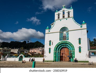 SAN JUAN CHAMULA, MEXICO - December 14, 2014: Local people gather around Traditional church wooden door and green sculpture. Traveling Chiapas state, Mexico adventure. Tradition and culture.