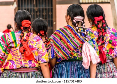 San Juan del Obispo, Guatemala -  August 3, 2018: Rear view of Guatemalan folk dancers in indigenous costume perform in village near UNESCO World Heritage Site of Antigua.