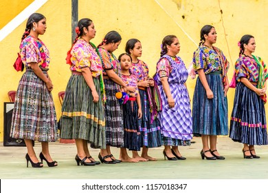 San Juan del Obispo, Guatemala -  August 3, 2018: Guatemalan folk dancers in indigenous costume perform in village near UNESCO World Heritage Site of Antigua.