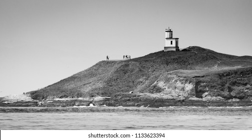 SAN JUAN ISLAND, WASHINGTON/U.S.A. - JULY 29, 2016: A black and white view of Lime Kiln Light, a functioning navigational aid located on Lime Kiln Point overlooking Dead Man's Bay.