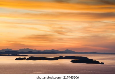 The San Juan Islands. Sunset over the San Juan Islands of Puget Sound in western Washington State, USA. Orcas Island, Clark and Barnes Island with Matia and Sucia in Canadian waters in the background.