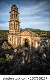 San Juan Parangaricutiro, in the Mexican state of Michoacán, is a small village near the Parícutin volcano. The village was destroyed during the formation of the Parícutin volcano in 1943