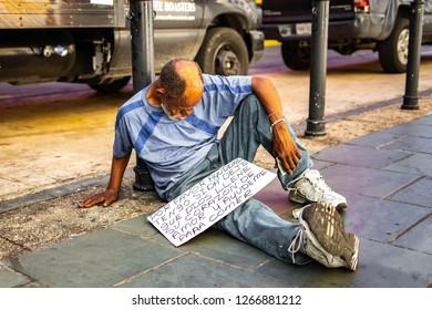 San Juan, Puerto Rico - 11/23/2018: Old homeless man on the street begging for help