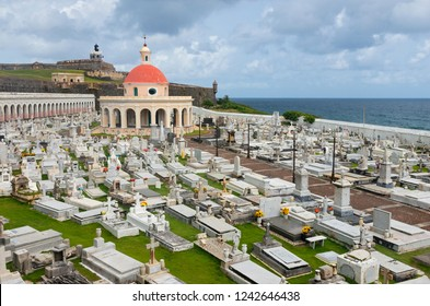SAN JUAN, PUERTO RICO –AUGUST 4, 2018: Landmark cemetery Santa Maria Magdalena De Pazzis and El Morro fortress along coast in Old San Juan.