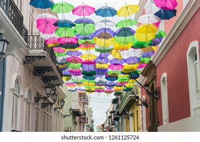 SAN JUAN, PUERTO RICO –AUGUST 4, 2018: Streets of Old San Juan decorated with colorful umbrellas. It is the oldest settlement within Puerto Rico and the historic colonial section  of San Juan.