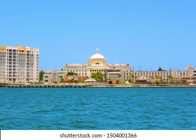 San Juan, Puerto Rico - August 20th 2019: Landscape view from the water, of a section of the coastline of San Juan, Puerto Rico, which includes the domed Capitol Office Government building.