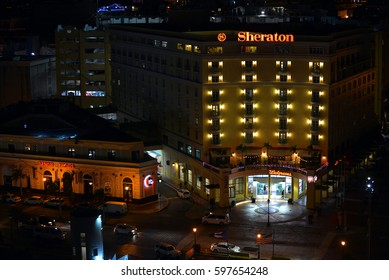 SAN JUAN, PUERTO RICO - FEB 28, 2017:  Nighttime view of Sheraton Hotel and Senor Frog's, as seen from Calle Marina Front of Pier Isla Bonita