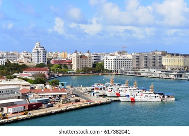 SAN JUAN, PUERTO RICO - FEB 28, 2017:  The US Coast Guard Sector with ships in the foreground and the skyline of the city in the background on a sunny day.
