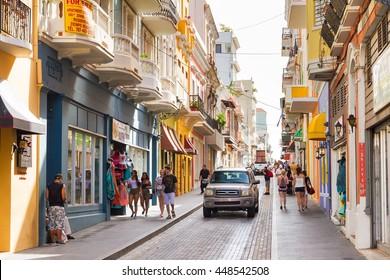 SAN JUAN . PUERTO RICO - JUNE 10, 2014: People shopping in the main street in San Juan, Puerto Rico, on June 10, 2014