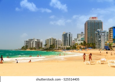 SAN JUAN, PUERTO RICO - JUNE 11, 2014: People relaxing at popular touristic Condado beach in San Juan, Puerto Rico, on June 11, 2014