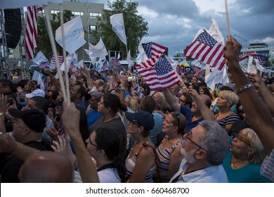 San Juan, Puerto Rico - June 11, 2017: Supporters of Statehood for Puerto Rico wave American flags at a rally celebrating their overwhelming win in a referendum on the island's political status.