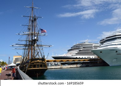 SAN JUAN, PUERTO RICO - MARCH 20, 2012:  HMS Bounty replica, moored in the harbor at San Juan, Puerto Rico, along with modern luxury liners.
