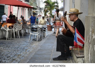 SAN JUAN, PUERTO RICO - MARCH 20:  A street performer serenades visitors for tips in Old San Juan on March 20, 2016.  Tourism revenue has remained relatively unaffected by the island's budget crisis.