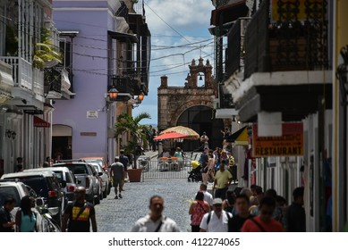 SAN JUAN, PUERTO RICO - MARCH 20:  Visitors explore the streets of Old San Juan on March 20, 2016.  Tourism revenue has remained relatively unaffected despite the island's budget crisis.