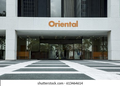 "San Juan, Puerto Rico - March 14, 2017: A woman exits Oriental Bank's branch in San Juan's financial district, known as the ""Golden Mile""."