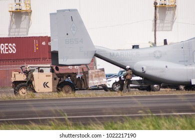 San Juan, Puerto Rico / United States - October 25 2017: Members of the military load food and water into cargo helicopters to be distributed in the central parts of the island of Puerto Rico.
