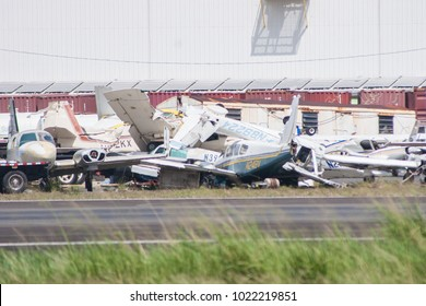 San Juan, Puerto Rico / United States - October 25 2017: Wreckage of planes that were blown together during Hurricane Mar still sit next to the runway at San Juan International Airport in Puerto Rico.