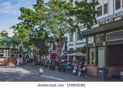 San Juan, Puerto Rico, USA - Jan. 2, 2018: Locals relaxing and enjoying a sunny afternoon in Plaza de Armas (Armas Square) in Old San Juan