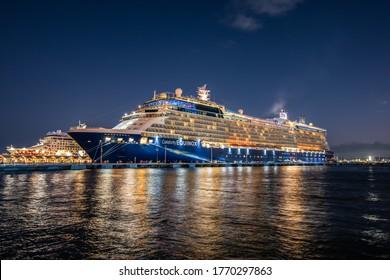 SAN JUAN, PUERTO RICO, USA - NOVEMBER 29, 2019: Cruise ships Celebrity Equinox (Celebrity Cruises) and Norwegian Gem (Norwegian Cruise Line) docked at the port of San Juan in Puerto Rico at night.