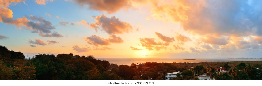 San Juan sunrise panorama view with colorful cloud and beach coastline.
