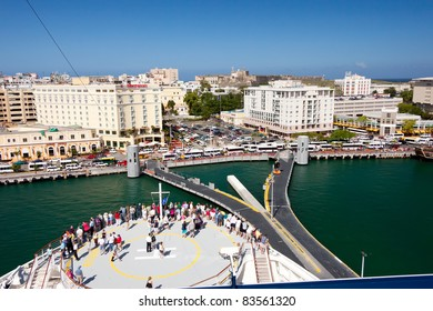 SAN JUAN,PUERTO RICO-JAN 18:Passengers enjoy the view of Old San Juan as ship docks on Jan.18, 2011 in San Juan.It's the Caribbean's most industrially developed island & a designated historic landmark