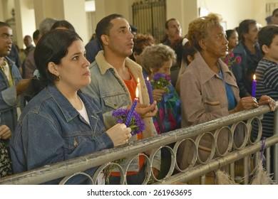 San Lazaro Catholic Church and people praying in El Rincon, Cuba