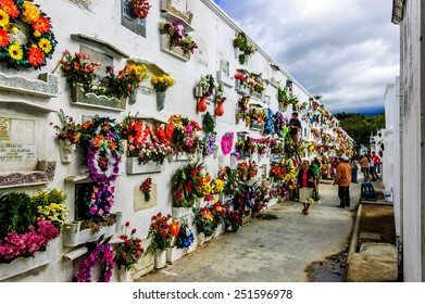 San Lazaro Cemetery, Antigua, Guatemala - Nov 2, 2014:  Flower covered wall of tombs on All Soul's Day in Spanish colonial town of Antigua.