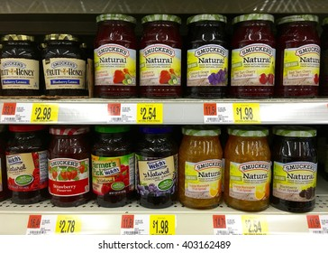 San Leandro, CA - April 08, 2016: Jars of Smucker's and Welch's brands jams and jellies on a store shelf display. Smucker's and Welch's are two of the biggest names in jellies and jams.