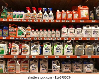 San Leandro, CA - August 22, 2018: Garden supply store shelf with containers of Round up chemical weed control agents. A C.A. jury just ruled that Roundup gave a school groundskeeper terminal cancer.