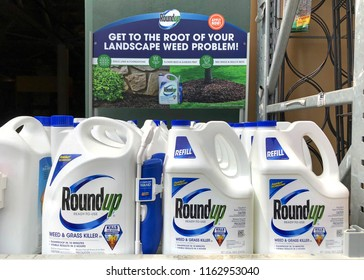 San Leandro, CA - August 22, 2018: Garden supply store shelf with containers of Round up weed control. A San Francisco jury just ruled that Roundup gave a former school groundskeeper terminal cancer.