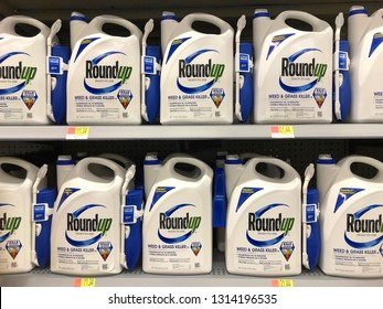 San Leandro, CA - February 13, 2019: Garden supply store shelf with containers of RoundUp weed killer. A San Francisco jury ruled that Roundup gave a former school groundskeeper terminal cancer.